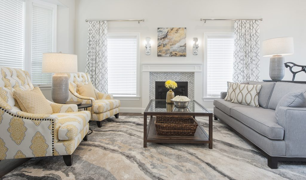 pretty living room in soft colour palette with fireplace focal point