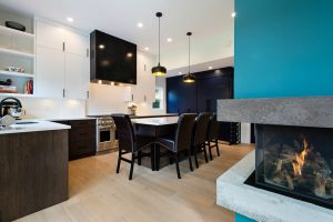 kitchen with unique turquoise and concrete fireplace