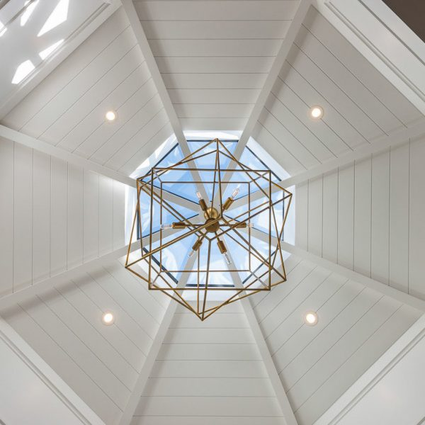 chandelier hung under a skylight in a dining room turret